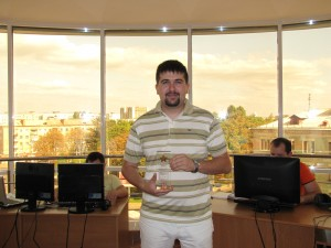 K. Makarov (CEO of AtomPark Software) with the Prize in his hands.